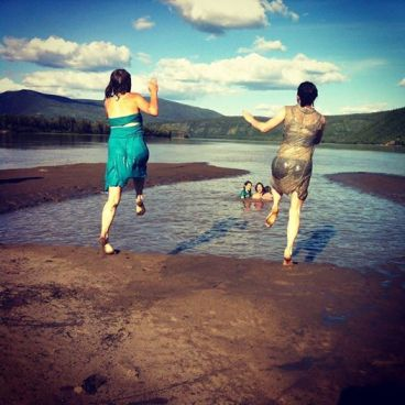 jumping into a mud pool in the Yukon